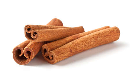 Fragrant cinnamon sticks isolated on white background Фото со стока - 30562472