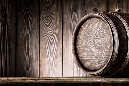 Fragment of old wooden barrels on planks background Stock Photo