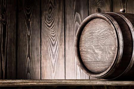 Fragment of old wooden barrels on planks background 版權商用圖片