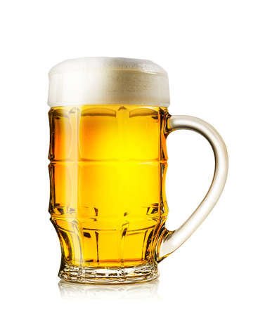 Big mug of fresh light beer with rich foam isolated on a white background Standard-Bild