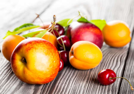 Fruits on the wooden table shot with a blurred background