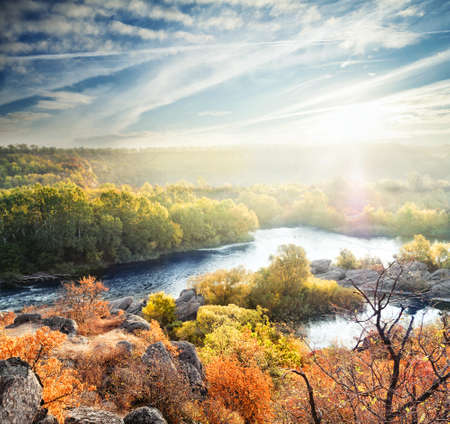 rifts: Autumn landscape with a mountain river and trees under a bright sun