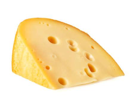 Stukje kaas liggend op zijn kant op een witte achtergrond Stockfoto