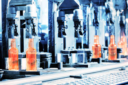 factory line: Manufacturing process of bottles in the glass factory