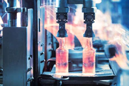 Casting glass bottles on the conveyor