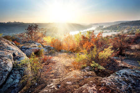 rifts: Dawn on banks of mountain river under blue sky Stock Photo