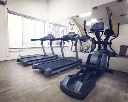 heavy effect: Cardio in the gym against the window Stock Photo