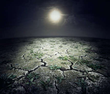 rainless: Dry cracked surface of planet under night moon Stock Photo