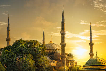 sun worship: Detail of the Sultanahmet Mosque (Blue Mosque) at sunset. Istanbul, Turkey. Stock Photo
