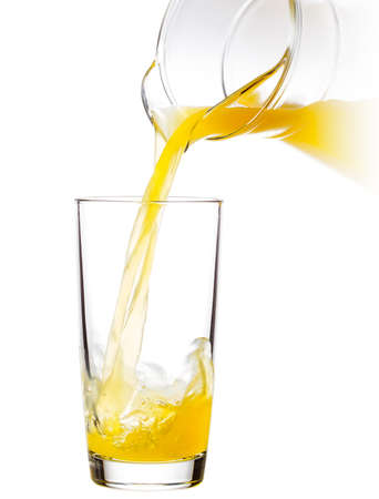 jet stream: Orange juice poured into an empty glass Foto de archivo