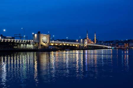 Galata bridge across the Bosphorus in the Istanbul at night. Istanbul, Turkey.