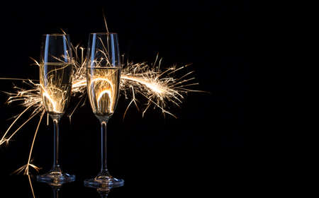 Two glasses of champagne in Bengal lights