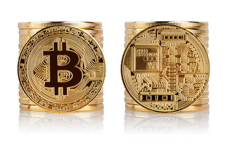 Front and back of bitcoin against the background of stack of coi Stock Photo
