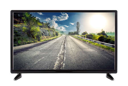 Flat high definition TV with mountain road on the screen