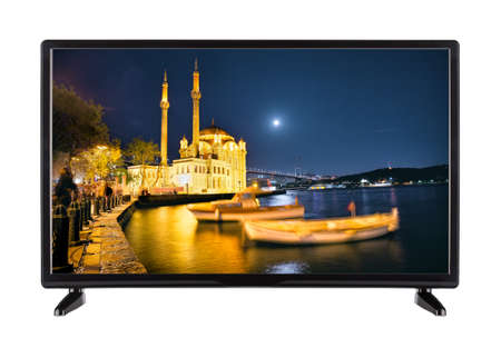 A modern high-definition television with  picture of the night q Stock Photo