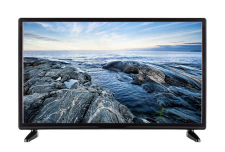 Modern flat TV with rocky shore on the screen