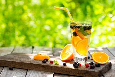 Homemade citrus cocktail lemonade on table in summer