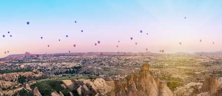 Multicolored balloons over the valley of Goreme at dawn. Cappadocia, Turkey.