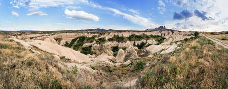 Sandy volcanic cliffs of Cappadocia in summer