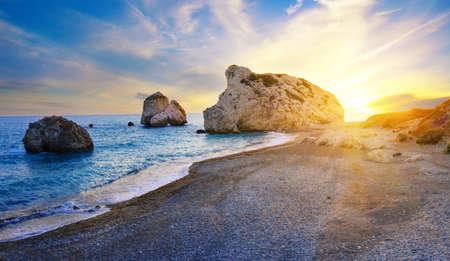 Aphrodites beach and stone at sunset in bright sunshine 版權商用圖片