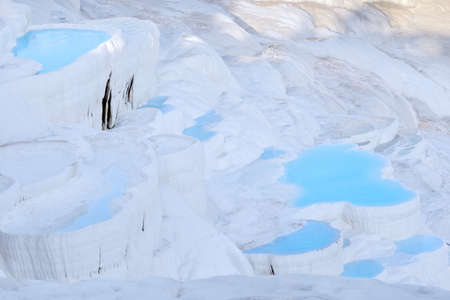 Blue water travertine pools in Pamukkale