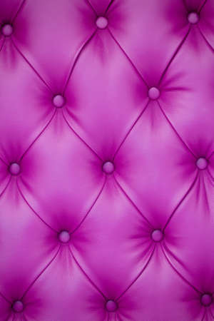Vertical background of pink leather furniture upholstery. Chesterfield Style