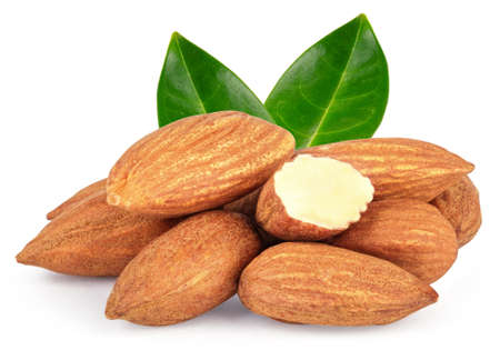 Almond nuts heap with green leaves isolated on white background