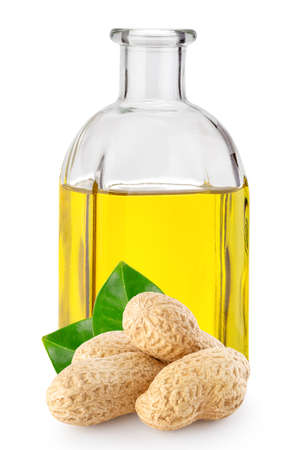Peanuts with leaves and peanut oil in square bottle Standard-Bild