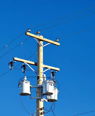 electrical tower: Transformer on a wooden post against the sky Stock Photo