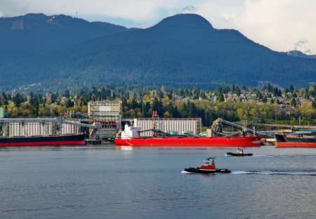 Two tugboats go along the port of North Vancouver photo