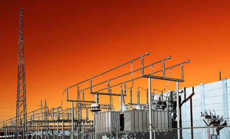 a power: Electrical Substation on the background of orange sky Stock Photo