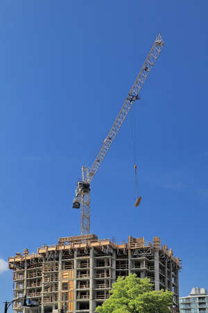 delivers: Construction crane delivers the material to the top of building