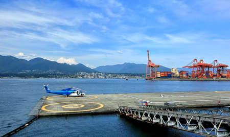 helipad: Helipad in  Vancouver;s Port,  Harbor, cranes, Port of Vancouver, North Vancouver, mountains