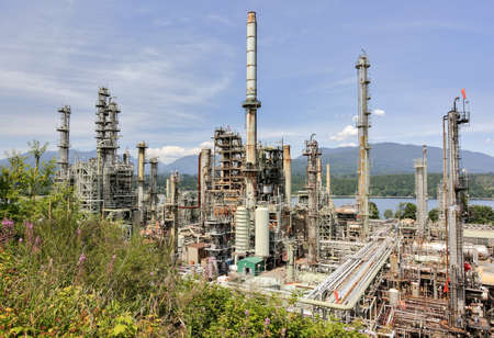 flare stack: Oil refinery on a background of nature, Burrard Inlet and mountain view Stock Photo