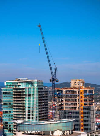 working stiff: New construction of high-rise building in Residential District of downtown Vancouver Stock Photo