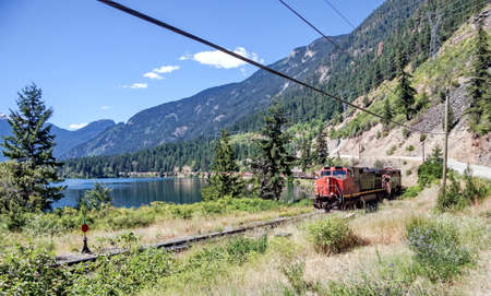 canadian pacific: Freight train goes on the Canadian Pacific Railway through the Birkenhead Lake Provincial Park Editorial