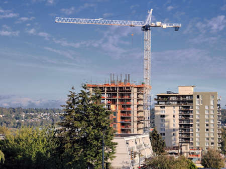 working stiff: Construction  of new high-rise building in New Westminster British Columbia Stock Photo