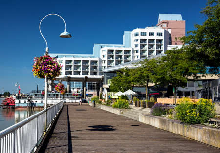Promenade  quay and a hotel on the  riverfront of Fraser River  in New Westminster city Stock Photo