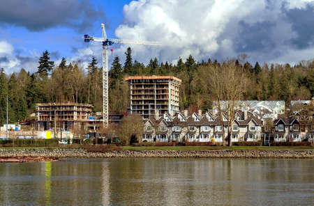 district of columbia: Construction of a new high-rise buildings in the city side of the riverbank in city of Vancouver