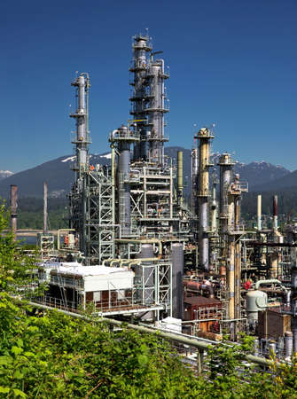 Oil refinery on a background of nature, Burrard Inlet and mountain view Stock Photo