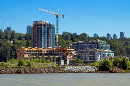 stiff: Construction of a new high-rise buildings in the city side of the riverbank in city of Vancouver