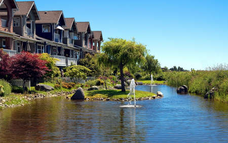 New residential area in a picturesque location near a pond with a fountain in the city of Richmond