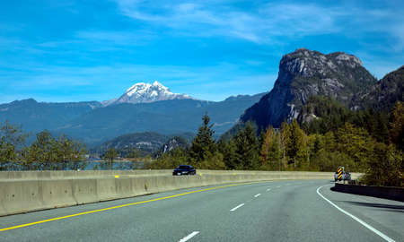 Sea to Sky Highway,  The mountain road from Vancouver  to Whistler and Lillooet Town on a background of coastline, blue sky and mountain range