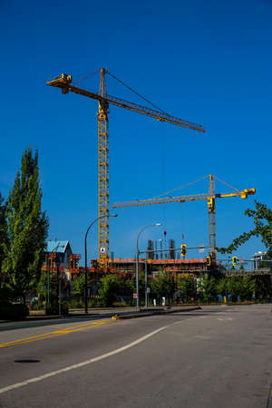 Construction of new building in residential area   in New Westminster city on the background of blue sky