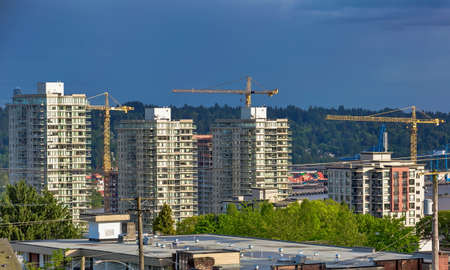 Construction of a new high-rise buildings in  residential district at the riverbank of New Westminster City, Vancouver, British Columbia, Canada