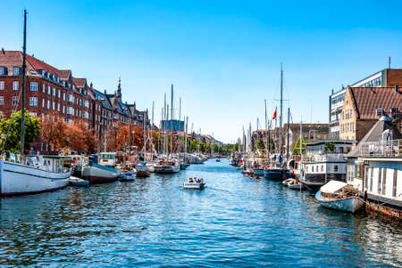 View of the harbor of Christianshavn, in Copenhagen, Denmark, with boats in a sunny summer day. Editorial