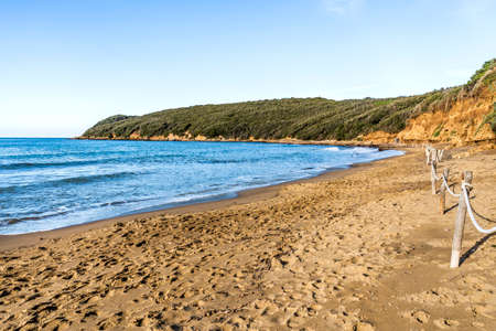 The sandy beach of the Gulf of Baratti, in the municipality of Piombino, along the Etruscan Coast, province of Livorno, Tuscany, Italy
