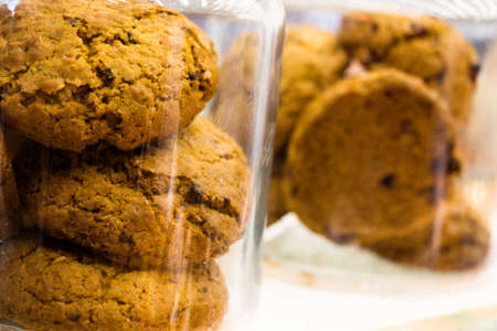 bakery products: Oatmeal cookies in a glass jar in a bakery.