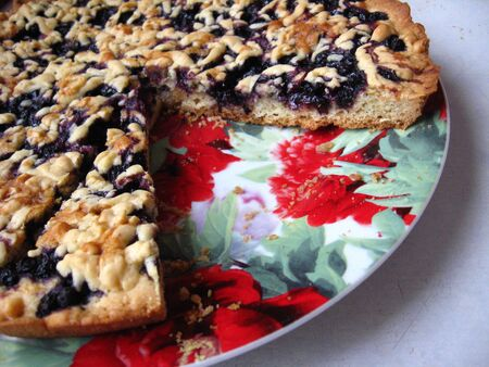 Fresh pie with bilberry on the plate