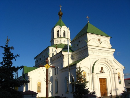 beautiful Christian church on the background of blue sky photo